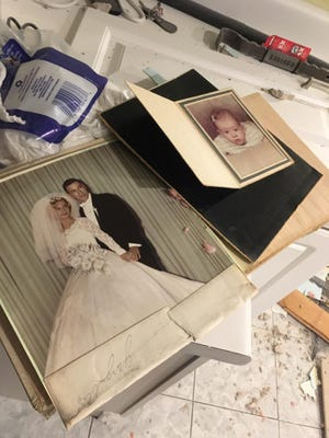 Megan and Bobby Kapsidis of Sierra Vista found this 1963 wedding album in a relative's family home in Florida. They are trying to return it to the owners.