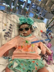 Victoria Landry , 2, has been in and out of hospitals