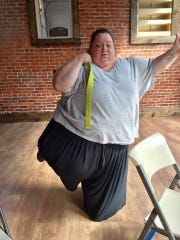 Amy Gartner doing yoga at Sage Yoga in Newark.