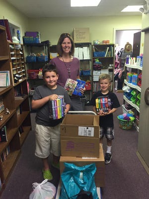 Colleen Aben, her son Rian Aben and Carter Hladki of Bloomfield Hills delivered the books at the end of last year's program.