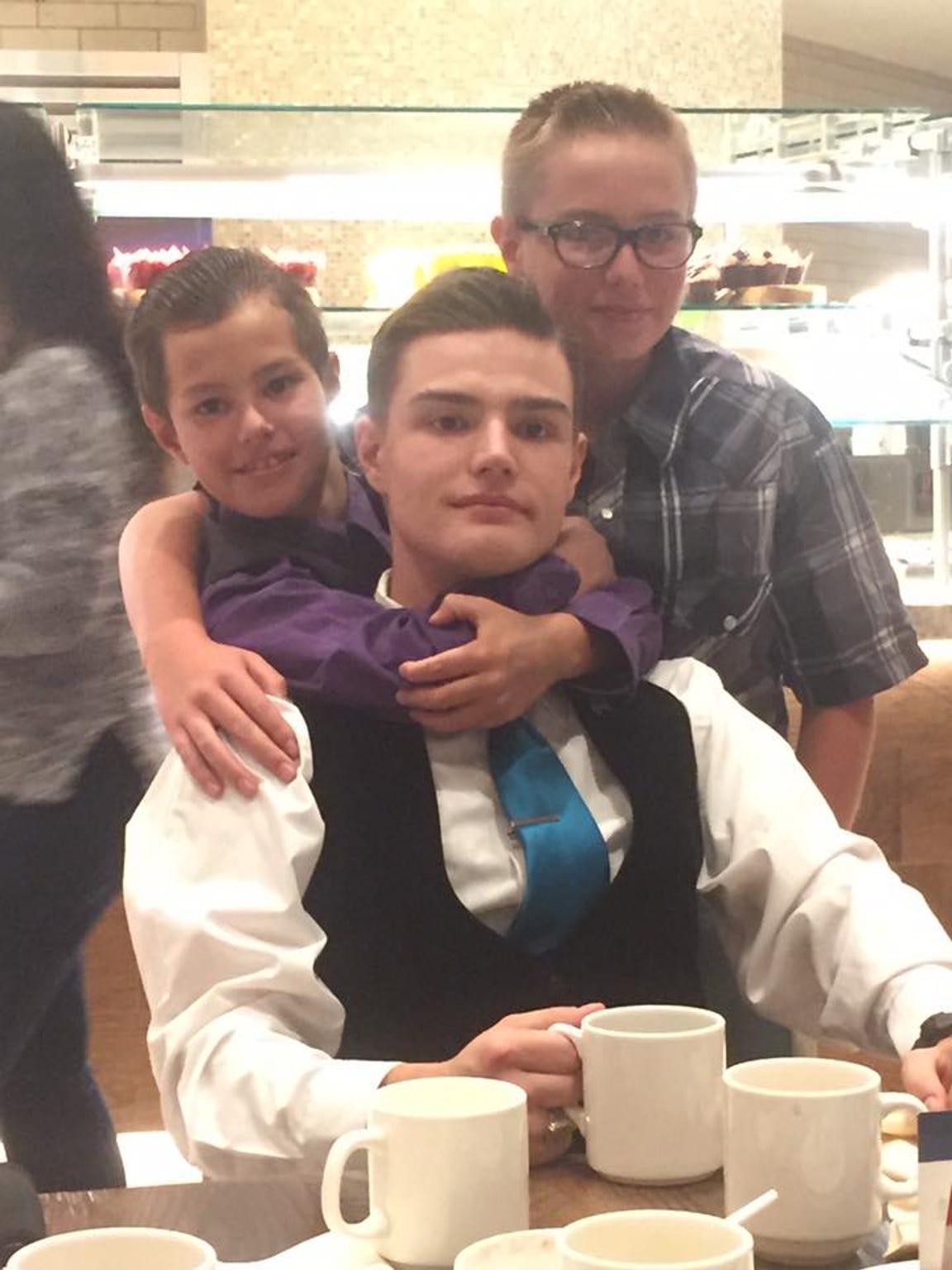Dillon Douglass with his brothers Nikolas and Josh