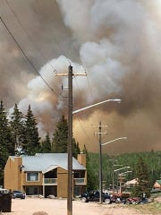 A wild fire burns outside of Brian Head on June 17