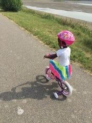 Amara Ochsner takes her bike for a spin at West Bank Park.