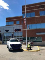The American flag is at half staff for Fire Chief Abraham Pitre in front of the Perth Amboy Fire Department headquarters.