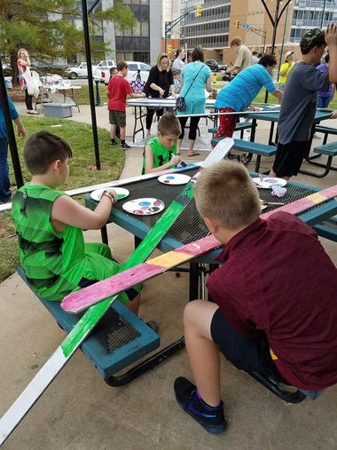 Youth paint pickets for the Wichita Falls Alliance