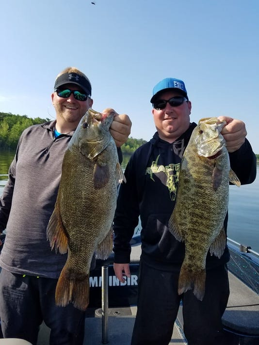 636335900791837157-Hooksetters-Guide-Adam-Rasmussen-putting-clients-on-some-giant-Door-Couty-Smallmouth-bass..jpg