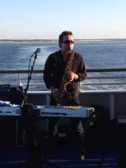 Glass Onion frontman Dale Teat performs aboard the Cape May-Lewes Ferry as part of the band's summertime Friday night residency.