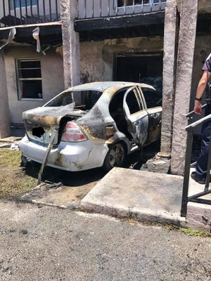 This image provided by the St. Lucie County Fire District shows the scene of a crash in which a car laden with propane tanks ran into an apartment building in the 400 block of Palm Avenue in Fort Pierce on Tuesday, July 4, 2017.