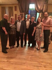 Danny Listmeier, his parents, Lani and Jerry Pollastro,