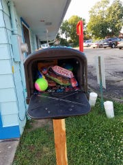 """Inside the """"Puppy Pantry,"""" people can find toys, food, treats and more for their dogs. The pantry, which sits outside of Groovy Grooming Galz in West Price Hill, operates on a """"take what you need, leave what you don't"""" basis."""