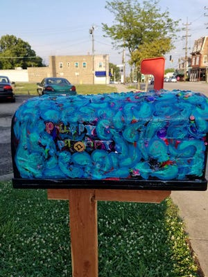 "The ""Puppy Pantry,"" a mailbox filled with food, treats, toys and more for those with dogs who otherwise can't afford them, sits outside Groovy Grooming Galz in West Price Hill."