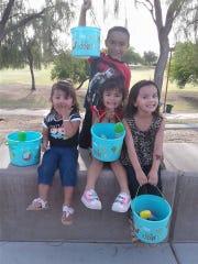 Emily, Mia, and Danial Garnica alongside Erica Raya-Garcia,