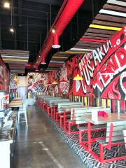 The modern, hip interior of Boss Tenders in far East