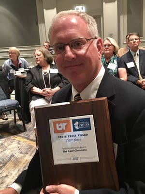 Jimmy Settle with his award for Best Business Coverage at the TPA awards Thursday night.