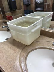 This photo was taken at the Fort Wright Golden Corral which stayed open without running water for several hours July 21. Patrons were asked to dip their hands in this plastic container after going to the bathroom.