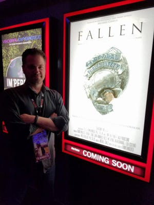 "Director Thomas Marchese stands with the poster for his documentary, ""Fallen,"" which screens Saturday in Visalia."