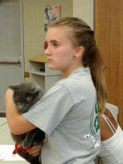 Sarah Huddleston, 15, of Florence, with her Russian Blue, Gracie.