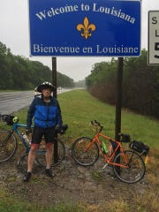 Steven Anderson stands in front of the Louisiana sign.