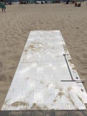 A part of a Matrax beach mat on the beach in Seaside
