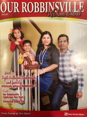 Dipti Kulkarni with her family on the cover of Our Robbinsville magazine.