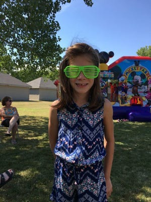 Birthday girl Emma enjoys her backyard birthday party.