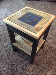 An end table Clark built by hand – complete with a Colts horseshoe in the middle.