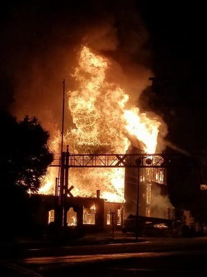 Flames engulf the historic Windsor Mill on Aug. 6.