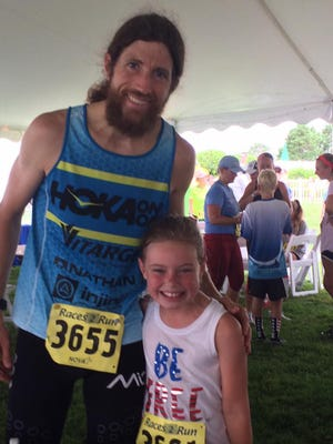 Michael Wardian poses with Maya Yngve at the Red White and Blue 5k in 2016 at the Delaware Tech campus in Georgetown.