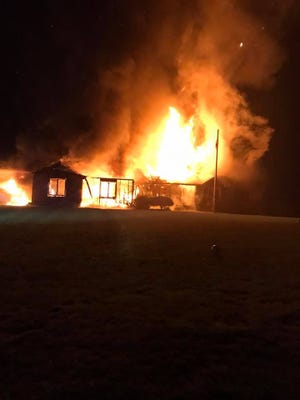 Fire engulfed a home on Douglas in Lyon Township early Aug. 9. The fire triggered explosions in the attached garage.