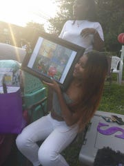 Siani Colon shows a photo collage of her father at