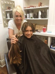 Ethan Fisher poses with hair stylist Lindsey Callaghan