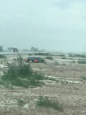 A fierce rainstorm the afternoon of Sunday, Aug. 13, 2017, stranded at least one car in the median of Interstate 25 south of the Doña Ana exit.