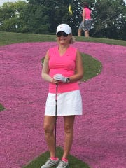 Cathey Helton, a breast cancer survivor, stands in