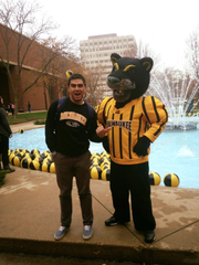 Sam with UW-Milwaukee's mascot Pounce the Panther at an event while attending school at UWM