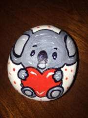 This rock was painted by Alisa Brown Corkern.