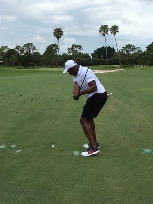 Golf Tournament participant Raphael Wendell makes a shot.