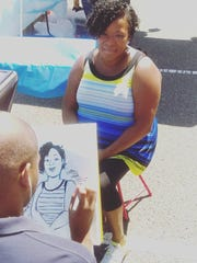 Caricature drawing at last year's festival.