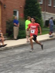 Waynesboro's Weber Long competes in the Krumpe's Donut Alley 5K in Hagerstown (Md.) on Aug. 12. Long completed the race in 21:17.
