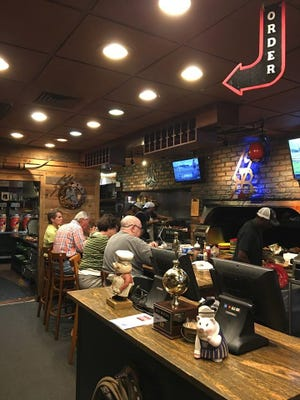 A full bar of 14 Bones diners helped raise money for the Mental Health Association of Indian River County.