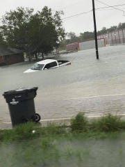 A pickup truck sits submerged in flood waters Wednesday