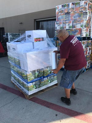 Angelo Movers wrapped pallets of supplies for extra security to transport to the coast to help with Hurricane Harvey clean up.