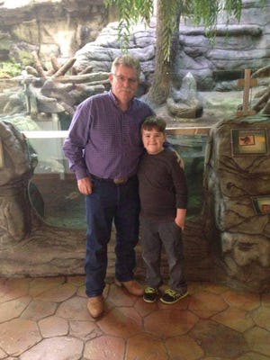 Cayden Holmes and his grandfather, Dan Johnson, enjoy a trip to the Oklahoma Aquarium in Tulsa.