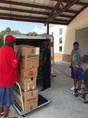 Hurricane relief supplies are loaded onto a trailer