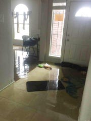 Water rose to about 8 inches in the Dickinson, Texas, home of April and Jarhett Groff. A few inches remained when they returned to their home after most of the flooding in the area receded.