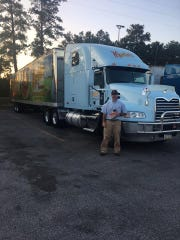 Dustin Martin poses for a photo before pulling out of Potato Roll Lane in Chambersburg with 18,000 packs of bread and rolls early Sunday morning. Martin was one of the drivers who helped deliver the goods to victims of Hurricane Harvey.