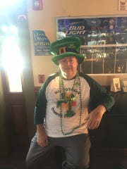 Steve Cowgill wears Ireland's green and orange inside Tavern on the Edge in Gloucester City. The Shamrock Festival goes on at noon Saturday.