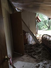 A tree fell through Meredith Hunter's mother's house