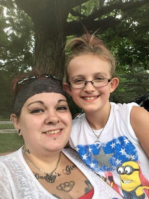 Ashley McCollum has her daugher, Melina Lakey, to thank for helping her escape her overturned car after an accident. The girl will be honored by the Girl Scouts.
