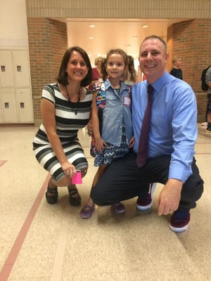 Steve Carlson, principal at Sandusky Jr./Sr. High School, poses with his wife, Erin Carlson, English teacher at Sandusky High School, and their kindergarten daughter, Rachel. Every member of Rachel's kindergarten class will receive a college savings account known as a Promise Fund through the Sanilac County Community Foundation. The initial amount in every fund has been doubled to $100, thanks to an anonymous Port Sanilac couple.