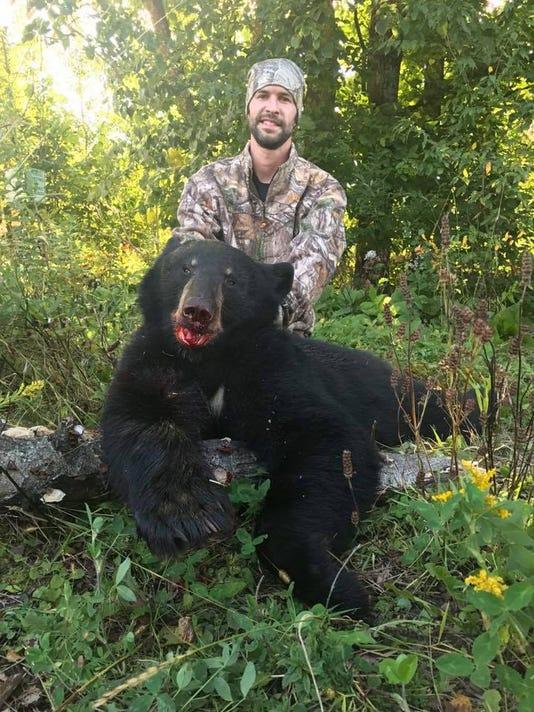 636415161106575439-Matt-Bearndt-with-a-Wisconsin-Black-Bear.-His-first-.jpg